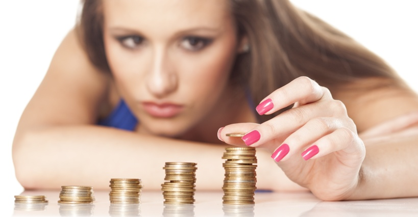 concentrated serious girl carefully arrange coins on the table